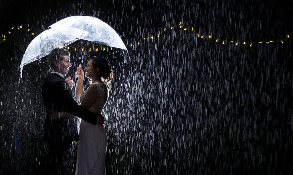 bride and groom raining at night
